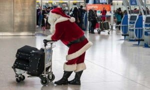 5491e123860c74c1162cae8d santa airport holiday travel