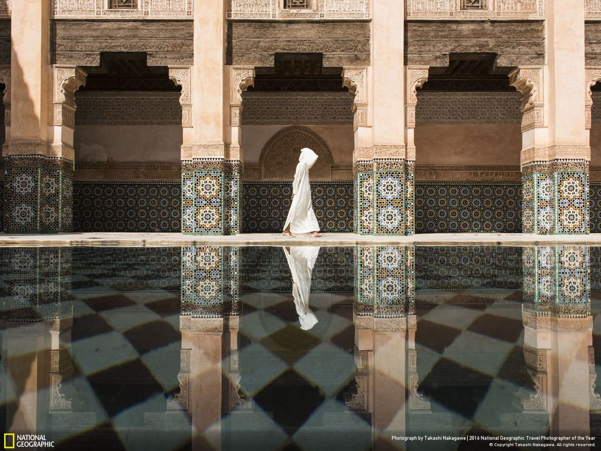 Marrakesh is an exciting city for any traveler, but I was tired of walking on the crowded street and being asked for money from local people, so I was looking for a place to settle down. Even though there were a lot of people in Madrasa, it was still a more quiet and relaxing place than outside. Suddenly a beautiful reflection appeared on the shallow pool when I was taking a rest. It was a cloudy day so I could only see it when the wind stopped blowing and sunlight hit this Islamic architecture. | CATEGORY: Cities